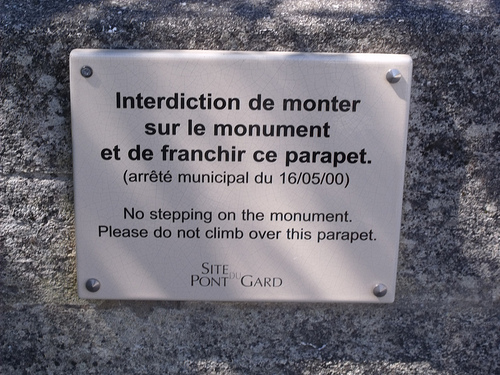 Pont du Gard -- sign - No stepping on the monument